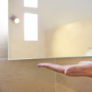 Motion activated bathroom mirror
